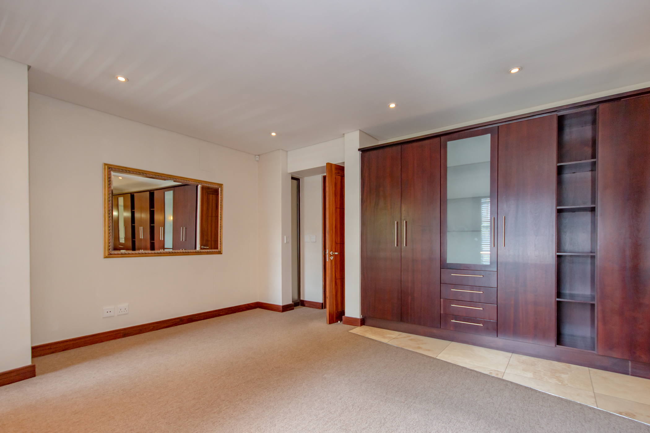"""""""Melrose arch luxury apartment bedroom with built in cupboards and en-suite bathroom"""" """"Flats for rent in Johannesburg"""""""