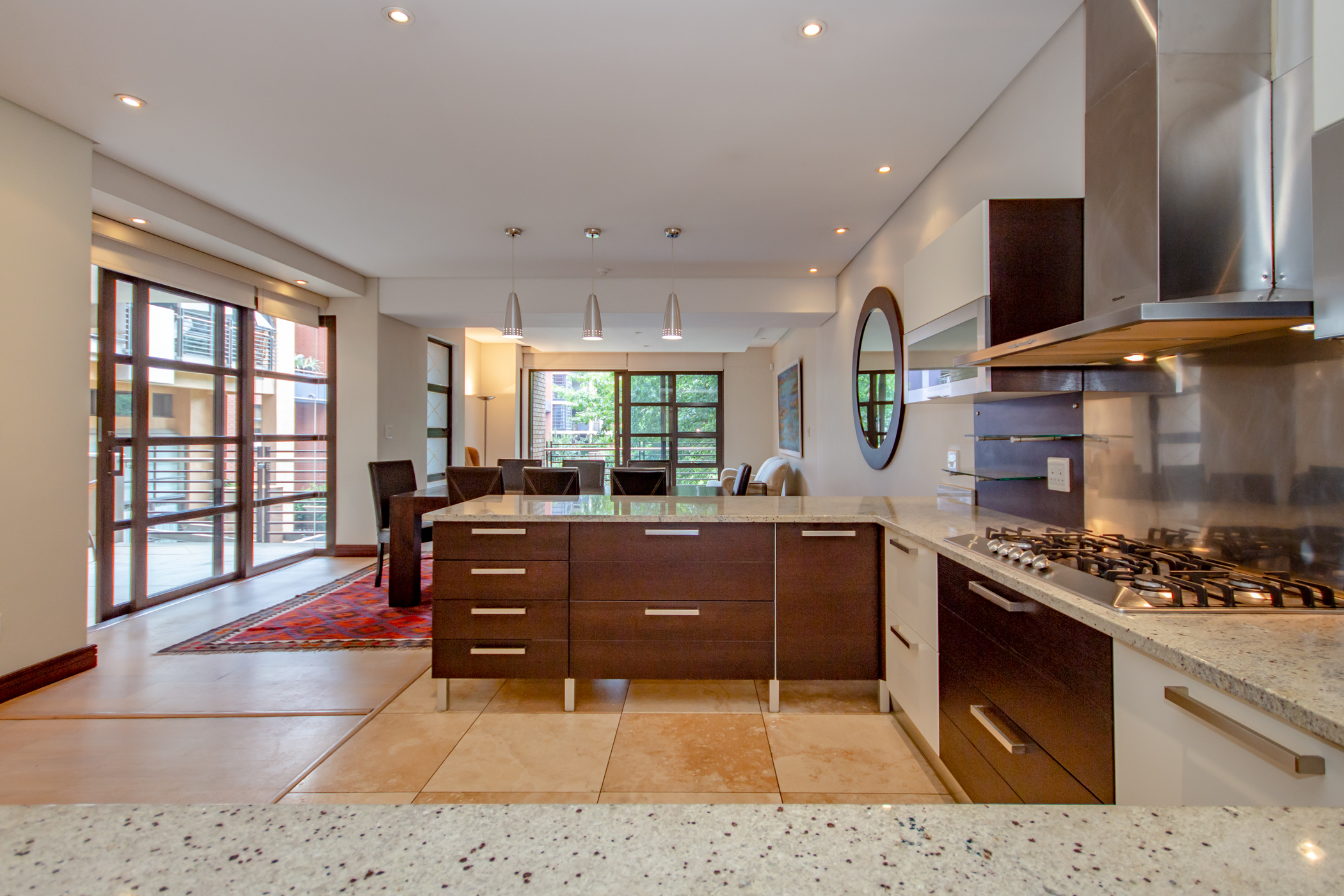 """""""Melrose arch luxury apartment kitchen with a view of the diningroom"""" """"Flats for rent in Johannesburg"""""""