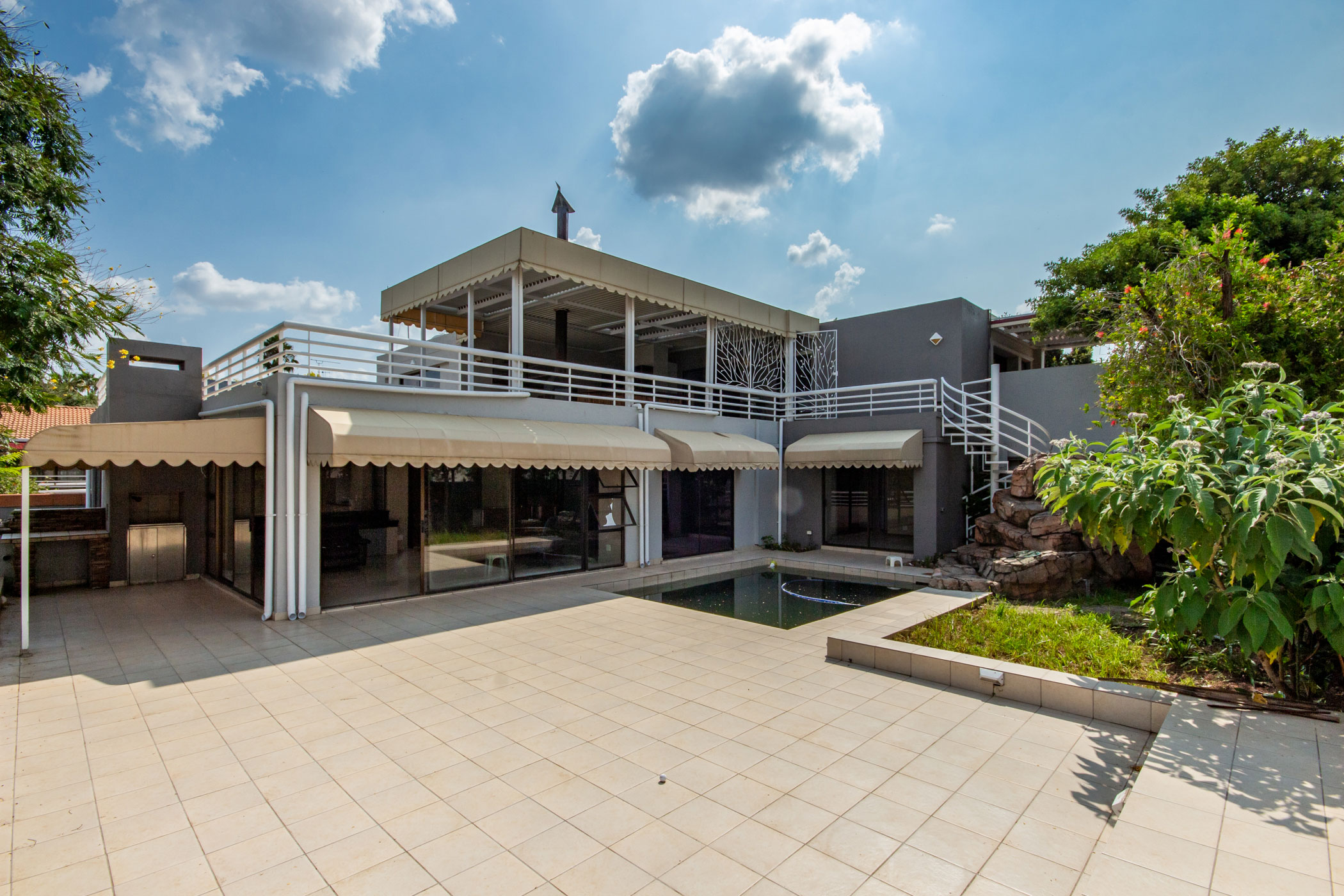 """""""patio and pool of Dainfern property"""" """"houses for auction Johannesburg"""""""